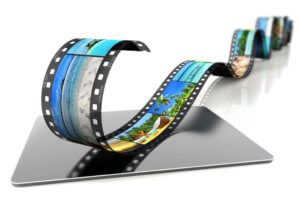film strip with tropical images on a laptop